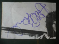 Ariel Bender's autograph on Brian May's hair