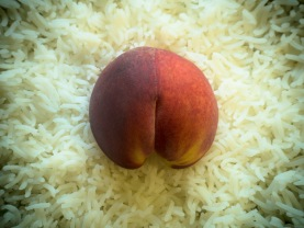 Half a Peach on a Bed of Rice